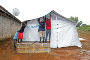 UNICEF team constructing Ebola isolation tent.