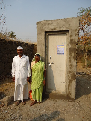 Beneficiaries in front of toilet