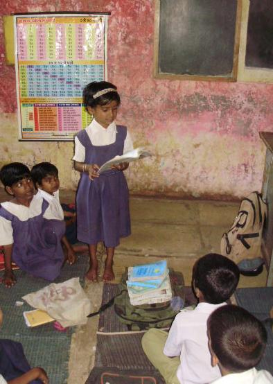 Harshida reading to the class