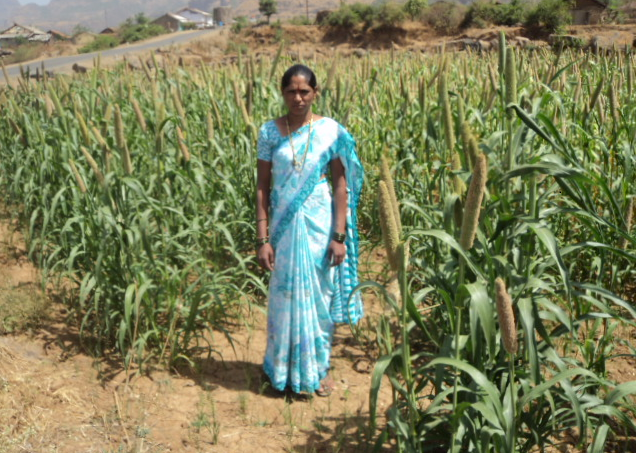 Kusum is proud to be working her own land.