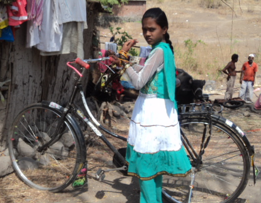 Rani with her new bicycle