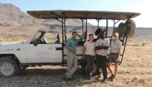 rhino tourists during a rhino tracking activity