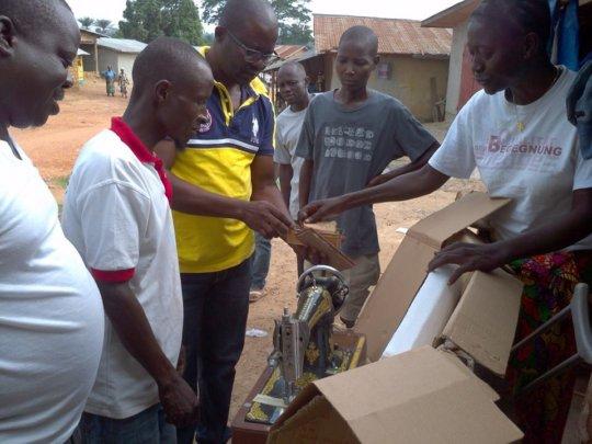 A training participant receives supplies