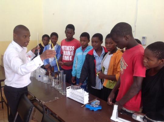 John demonstrating with new lab equipment
