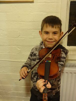 Artus is excited beyond belief to learn the violin