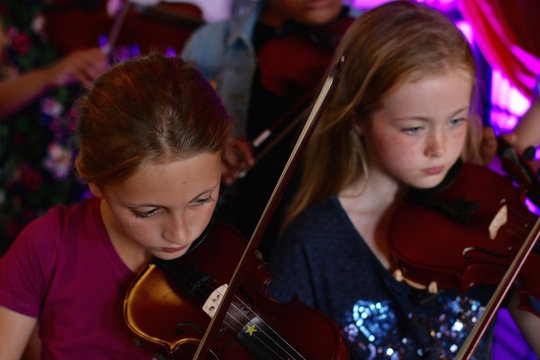 Fiddle players performing in our concert