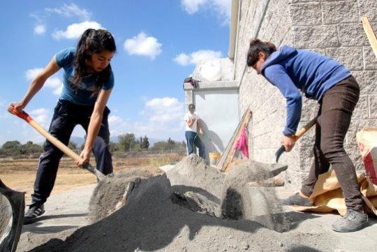 Young women prepare cement in Cerritos