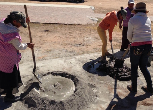 Community women mixing cement
