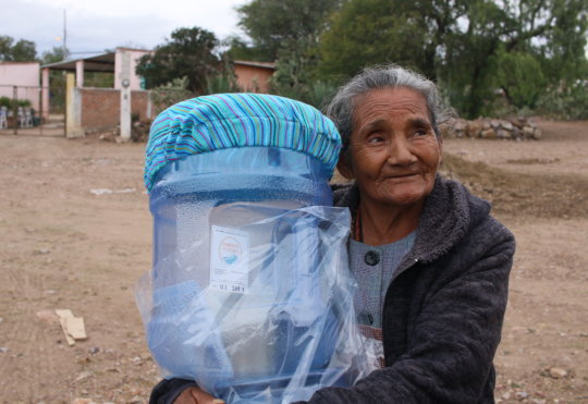 Woman in Llano Verde receives her filter system