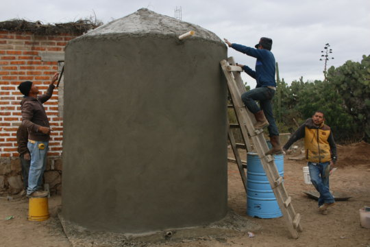 Finishing up a cistern in a local community