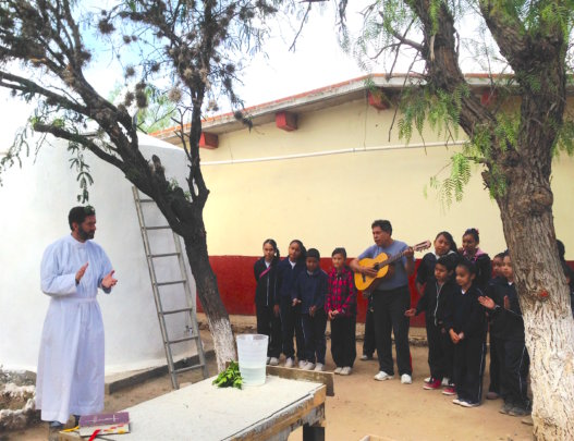 Students perform to inaugurate rainwater project