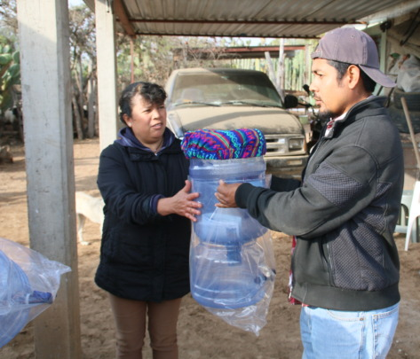 Delivering filter systems at a local community