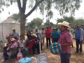 Caminos staff explains the ceramic filter
