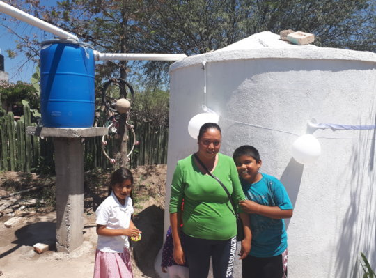 A family celebrates their new rainwater system