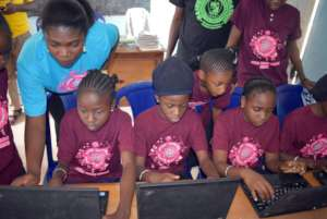 Kids enjoying there new computers.