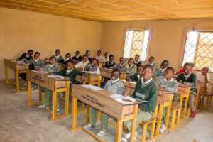 A classroom with donated table and students