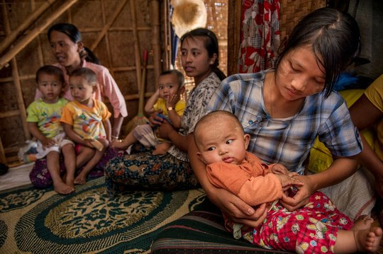 Midwives holding babies at a community training