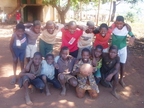 A team of young boys from Gurue's polo 9, pose for a serious tea