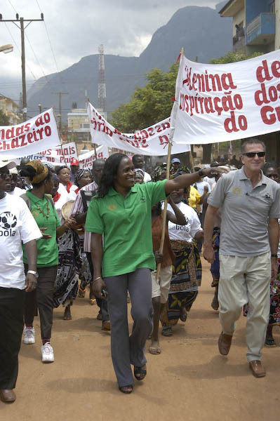 Maria with the Ambassador lead a parade in Gurue.