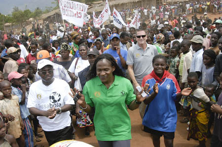 Maria with the Ambassador in a crowd in Gurue