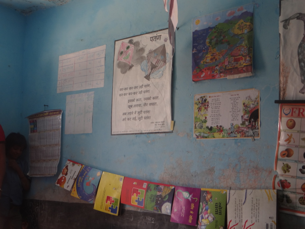 Posters and books.At the centre, the poem on kites