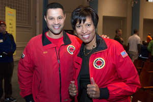 DC Mayor Bowser received a City Year Red Jacket.