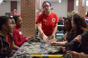 An AmeriCorps Member lead volunteers in service.