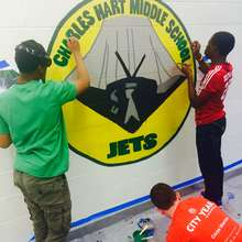 DC high school students rehabilitate an old mural.