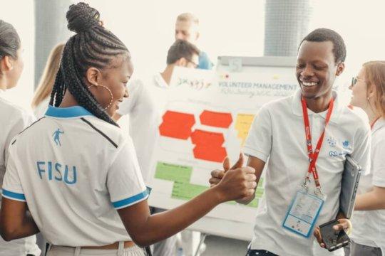 Maya interacting with fellow FISU members