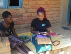 Lingalira Mawa co-founder counseling a teen mother