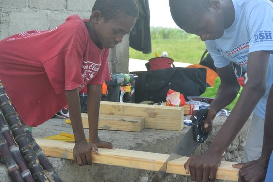 Learning by doing, helping with housebuilding