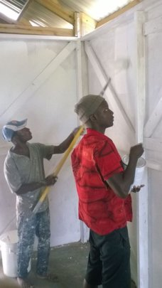 LFBS Youth helping paint new family home