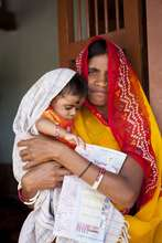 Mother with her child in an immunization camp