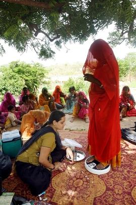 Nurse taking antenatal care of tribal women
