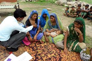 Narmada with her child in Immunization Camp