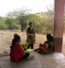 Lydia interacting with tribal women