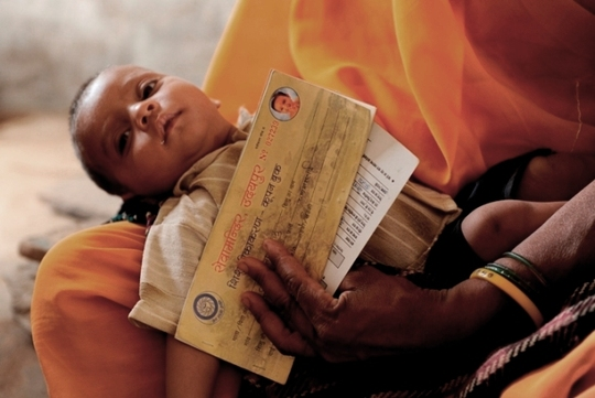 Mother holding her child to get his vaccination.