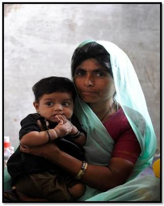 mother with her child at the immunization camp