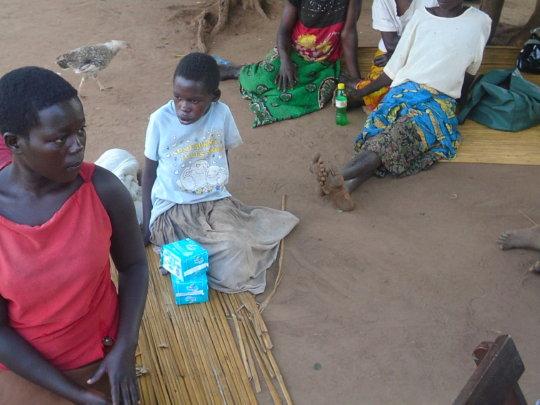 Teen age girl receiving sanitary pads