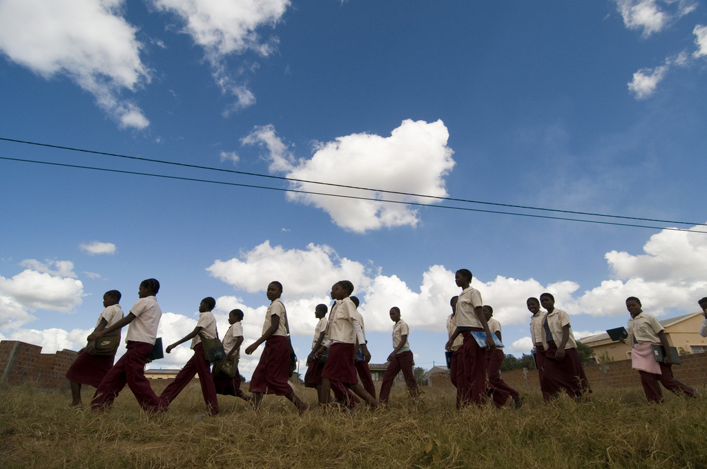 The girls walking to school under the big Magude sky.