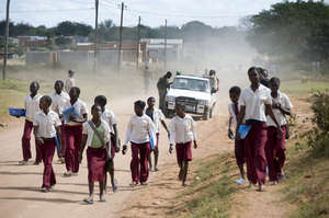 Off to school in dusty Magude