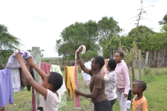 Malel with other rescue girls washing clothes