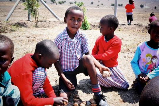 Pre-school children playing with stones