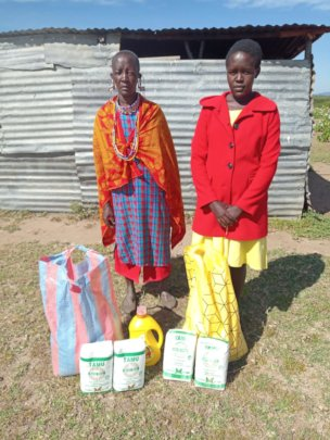 Felister and her mother receive food gift