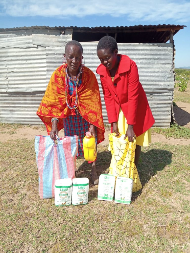 Felister and her mother receive food donation