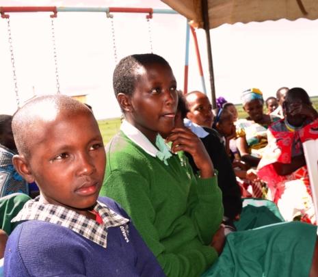 Sponsored children listen to their Governor