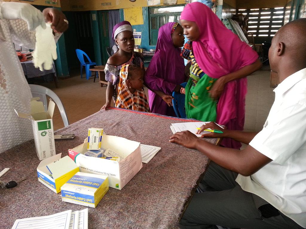 Mother & child for RDT malaria diagnosis & treatme
