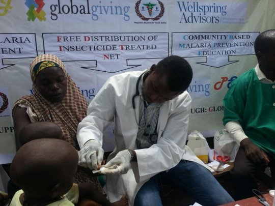 A suspected malaria patient undergoing RDT testing