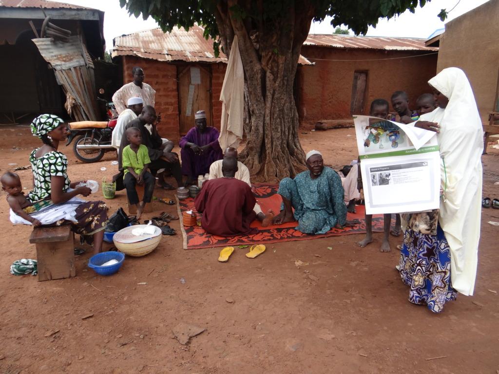 IPC Facilitator educating Caregivers about malaria