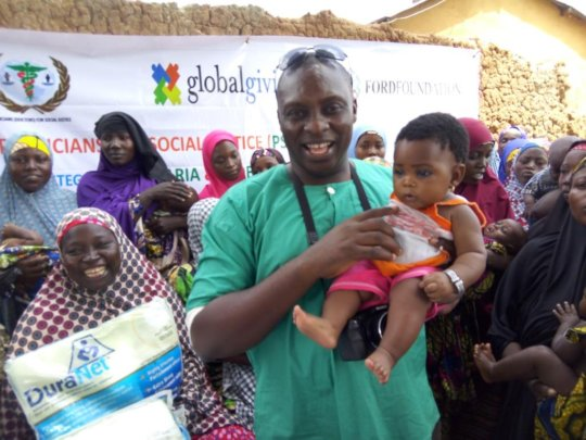 8 month old Hannatu carried by health team member